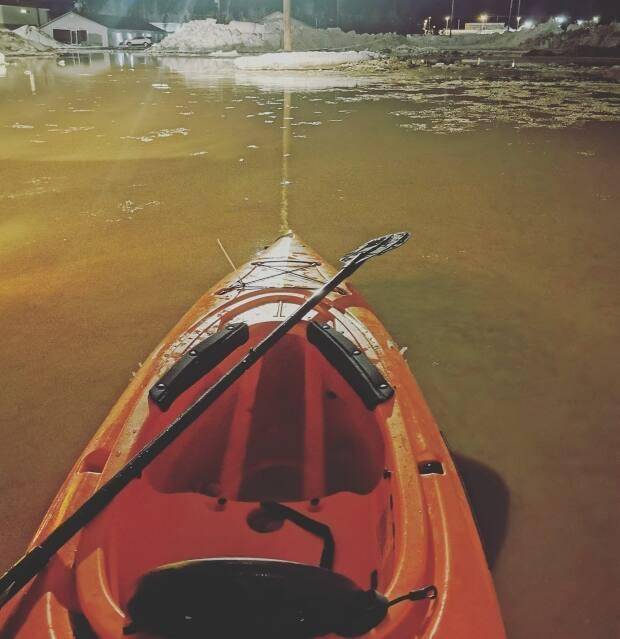 Weekend warming in Happy Valley-Goose Bay has led to flooding across the community. Becky Michelin took this photo while kayaking down a road in the town. (Becky Michelin - image credit)