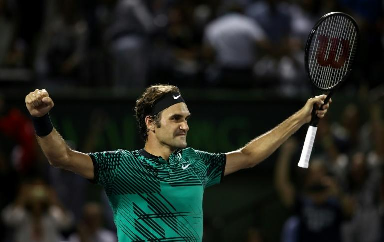 Roger Federer of Switzerland celebrates defeating Nick Kyrgios of Australia in the semi-finals at the Miami Open