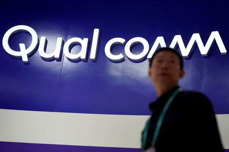 FILE PHOTO: A Qualcomm sign is seen during the China International Import Expo (CIIE), at the National Exhibition and Convention Center in Shanghai, China November 6, 2018. REUTERS/Aly Song/File Photo