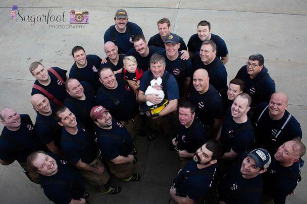 PHOTO: Grandfather, Jack Korves, holds baby Brett with the Swansea Fire Department. (Sugarfoot Photography)