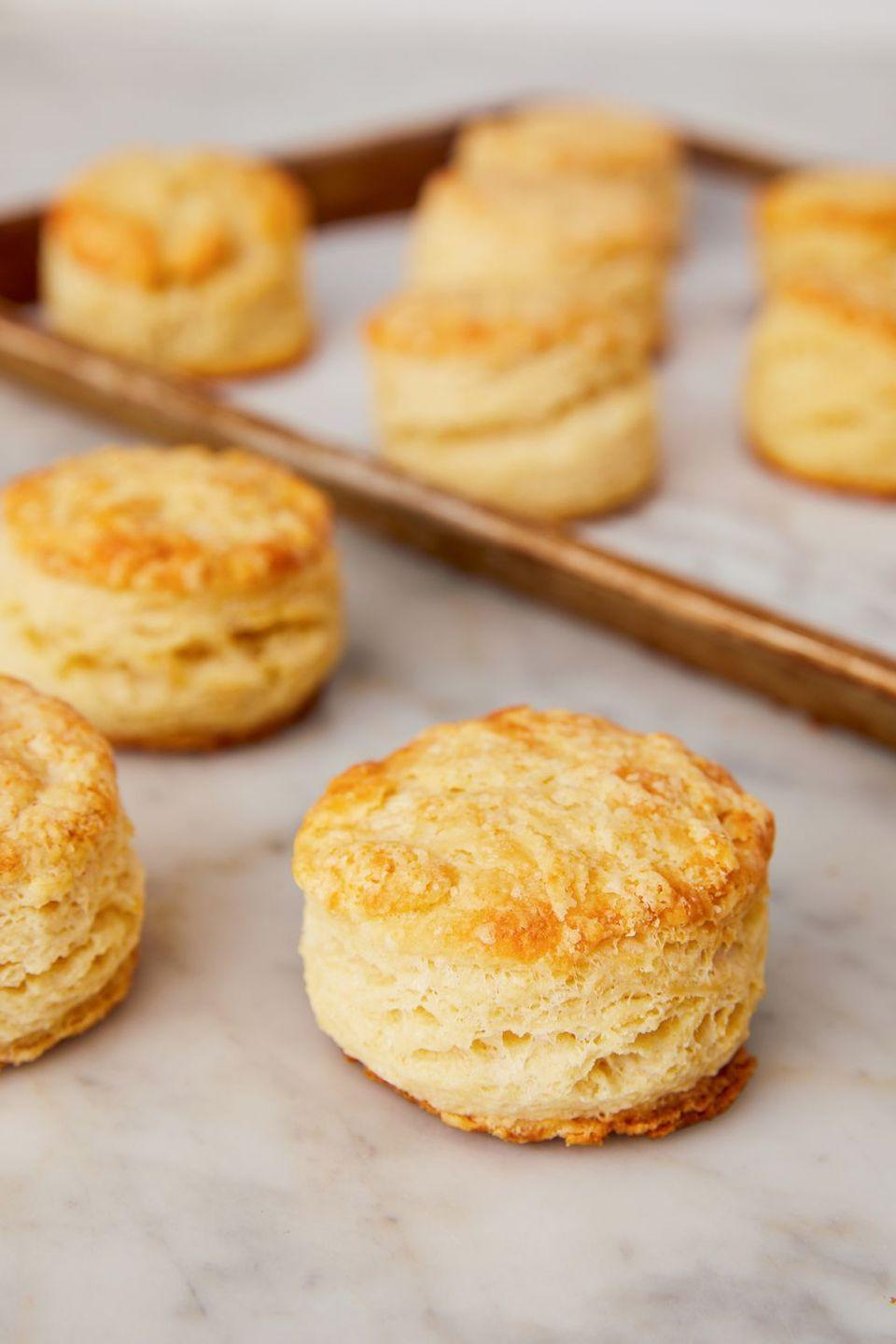 "<p>A few simple ingredients, when carefully mixed together, create a soft, pillowy roll of comfort.</p><p>Get the recipe from <a href=""https://www.delish.com/cooking/recipe-ideas/a23712163/easy-biscuits-recipe/"" rel=""nofollow noopener"" target=""_blank"" data-ylk=""slk:Delish"" class=""link rapid-noclick-resp"">Delish</a>.</p>"