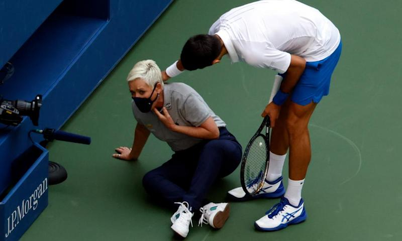 Novak Djokovic tries to help a line judge whom he hit in the throat with a ball.