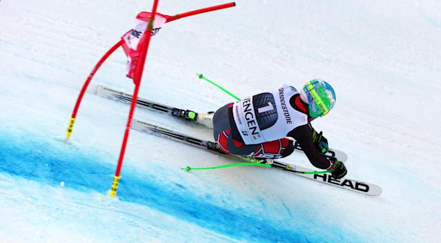 Ted Ligety, of the United States, competes on his way to win an alpine ski, men's World Cup super-combined, in Wengen, Switzerland, Friday, Jan. 17, 2014. (AP Photo/Alessandro Trovati)
