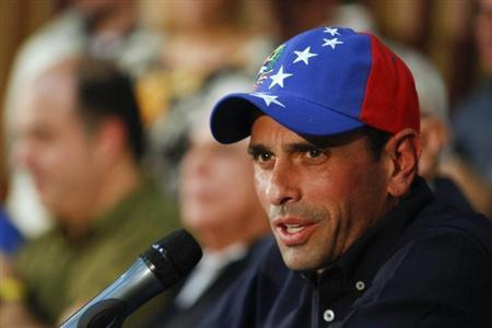 Venezuela's opposition leader and governor of Miranda state Henrique Capriles answers a question during a news conference in Caracas
