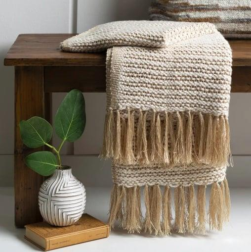 """<p>I had to have one splurge item on the list, namely this <span>Champagne Lightweight Throw Blanket</span> ($69) from Jungalow. Just imagine snuggling up with this delicate, hand-woven, cotton knit during your first <a class=""""link rapid-noclick-resp"""" href=""""https://www.popsugar.com/Halloween"""" rel=""""nofollow noopener"""" target=""""_blank"""" data-ylk=""""slk:Halloween"""">Halloween</a> movie marathon. Pure bliss.</p> <p>Click <a href=""""https://www.popsugar.com/smart-living/Health-Wellness-Tips-46521311"""" class=""""link rapid-noclick-resp"""" rel=""""nofollow noopener"""" target=""""_blank"""" data-ylk=""""slk:here for more health and wellness stories, tips, and news"""">here for more health and wellness stories, tips, and news</a>.</p>"""