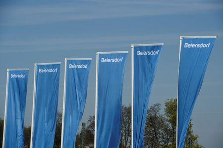 FILE PHOTO: Flags of German personal-care company Beiersdorf are pictured at the annual shareholders meeting in Hamburg