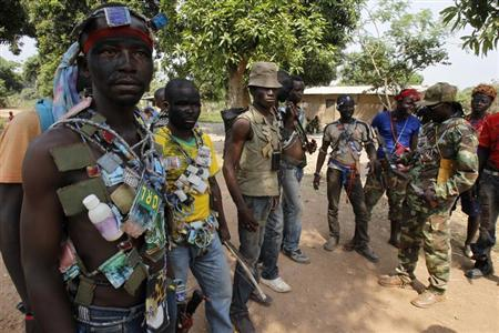 "Fighters from the Christian ""anti-balaka"" militia stand at their headquarters in the northern Bangui suburb of Boeing"