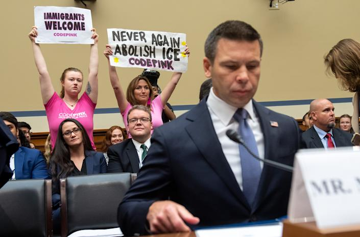 Acting Secretary of Homeland Security Kevin McAleenan with immigration policy protesters. (Photo: Saul Loeb/AFP/Getty Images)