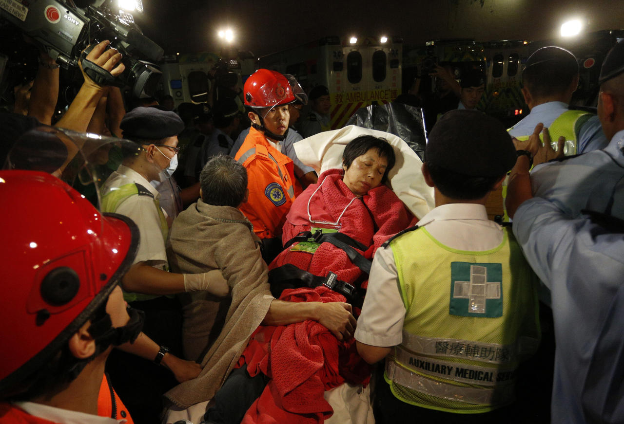 A survivor carried by rescuers, is taken onto shore after a collision involving two vessels in Hong Kong Tuesday, Oct. 2, 2012. Authorities in Hong Kong have rescued 101 people after a ferry collided with a boat and sank. A local broadcaster says eight people died.The government said in a statement that the ferry was carrying about 120 people when the accident happened Monday night near Lamma Island, off the southwestern coast of Hong Kong Island. Few other details were given. (AP Photo/Vincent Yu)