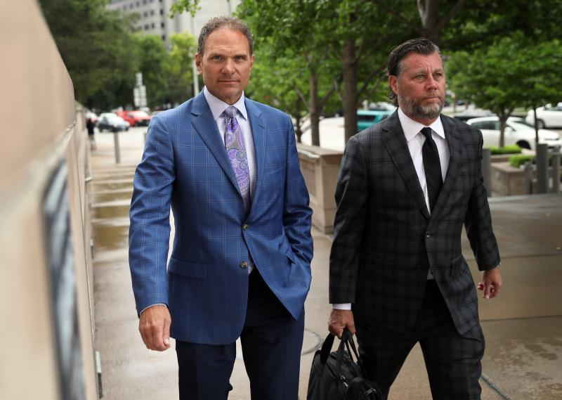 Businessman John Rallo, left, and his lawyer John Rogers arrive at federal court in St. Louis on Tuesday, July 16, 2019. Rallo has admitted in federal court that he provided bribes as part of former St. Louis County Executive Steve Stenger's pay-to-play scheme, the fourth person to plead guilty in connection with the crime. Rallo pleaded guilty Tuesday, June 16, 2019 to three counts of bribery. (David Carson/St. Louis Post-Dispatch via AP)