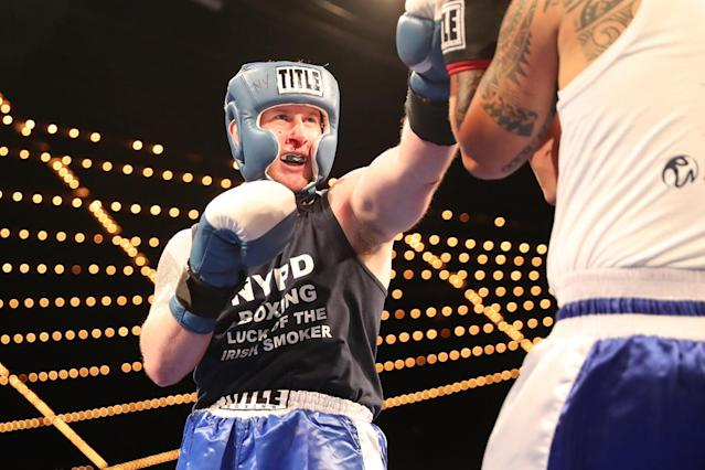 <p>New York's Finest Matt Rooney throws a jab at Jonathan Alvarez at the NYPD Boxing Championships at the Theater at Madison Square Garden on June 8, 2017. (Photo: Gordon Donovan/Yahoo News) </p>