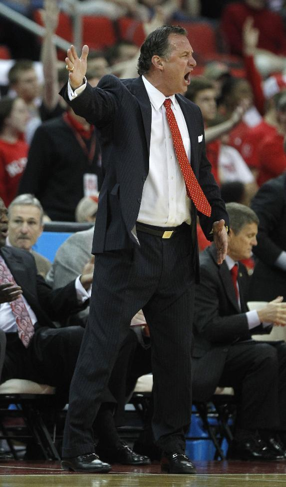 North Carolina State's coach Mark Gottfried reacts to a call during the first half of the NCAA college basketball game against Boston College at PNC Arena in Raleigh, N.C., Sunday, March 9, 2014. (AP Photo/The News & Observer, Ethan Hyman )