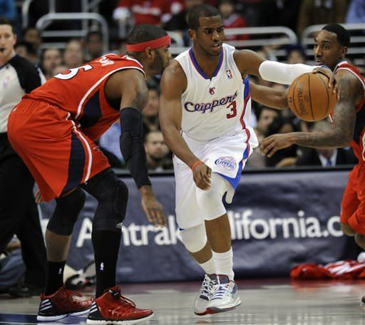 Los Angeles Clippers guard Chris Paul (3) keeps the ball away from Atlanta Hawks forward Josh Smith (5) during the first half of an NBA basketball game in Los Angeles , Wednesday, March 14, 2012. (AP Photo/Lori Shepler)