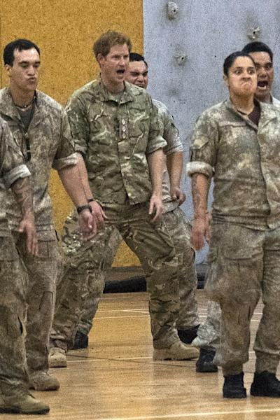 Britain's Prince Harry (C) performs the haka with New Zealand Army personnel, during his visit to Linton Military Camp near Palmerston North, on May 13, 2015 (AFP Photo/Marty Melville)