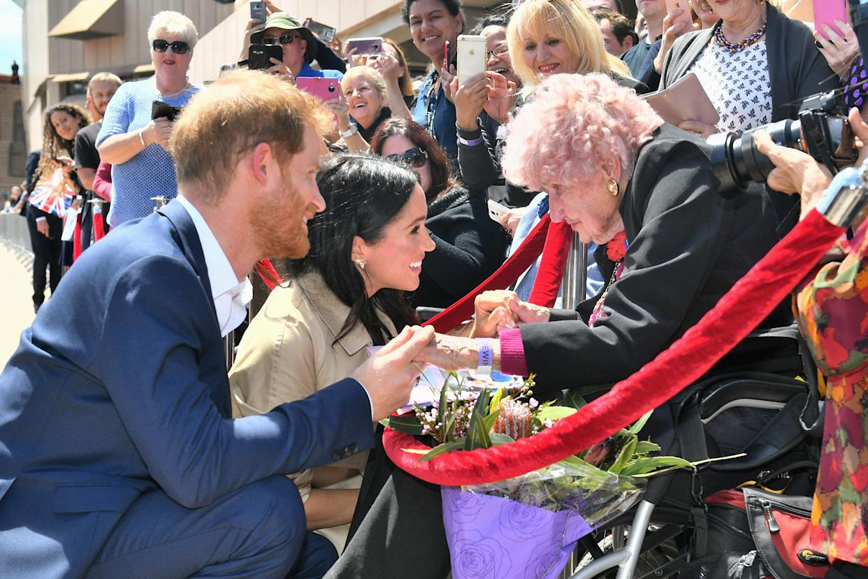 Meghan Markle meets Daphne Dunne, a superfan of Prince Harry's. (Photo: Getty Images)