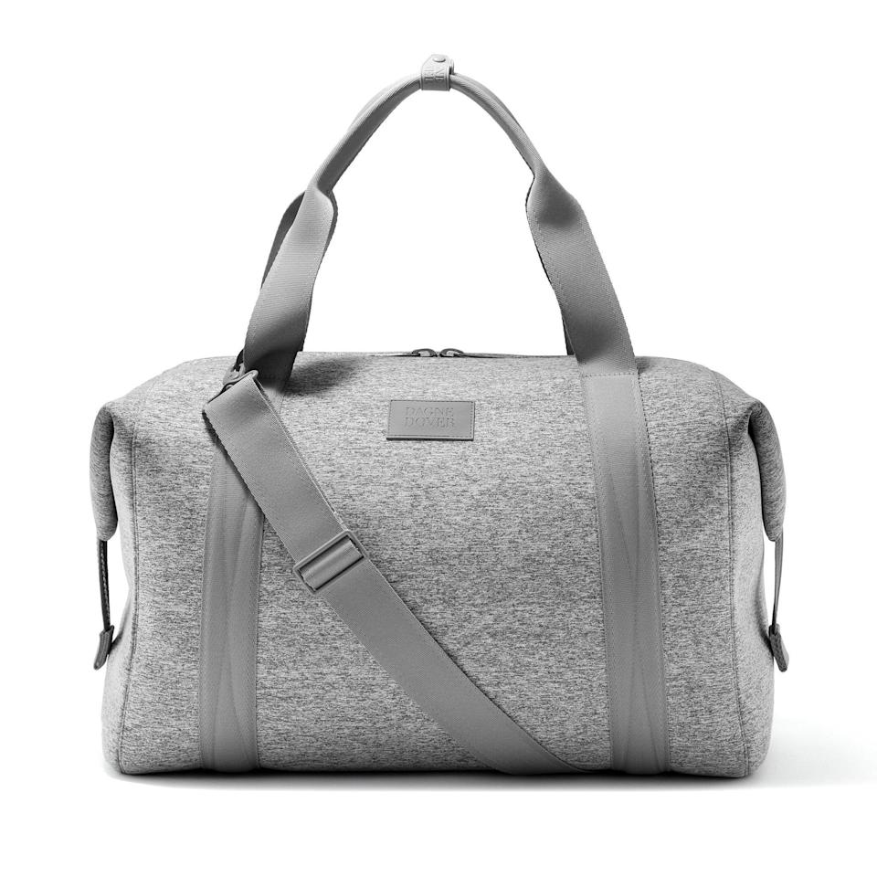 """<h2>Dagne Dover Landon Carryall</h2><br><strong>The Type: </strong>Extra-large weekender<br><br><strong>The Hype:</strong> 4.7 out of 5 stars and 2,010 reviews at Dagne Dover<br><br><strong>What Travelers Say: </strong>""""Best bag for plane travel. This is the perfect size to sit on top of your carry on suitcase. Fits under the seat even when filled to capacity. My new favorite everything bag. I look for reasons to use it."""" – <em>Angelina, Dagne Dover Reviewer</em><br><br><em>Shop</em> <strong><em><a href=""""https://www.dagnedover.com/"""" rel=""""nofollow noopener"""" target=""""_blank"""" data-ylk=""""slk:Dagne Dover"""" class=""""link rapid-noclick-resp"""">Dagne Dover</a></em></strong><br><br><br><strong>Dagne Dover</strong> Landon Carryall Bag, $, available at <a href=""""https://go.skimresources.com/?id=30283X879131&url=https%3A%2F%2Fwww.dagnedover.com%2Fcollections%2Fthe-landon-carryall%23HeatherGrey-ExtraLarge"""" rel=""""nofollow noopener"""" target=""""_blank"""" data-ylk=""""slk:Dagne Dover"""" class=""""link rapid-noclick-resp"""">Dagne Dover</a>"""