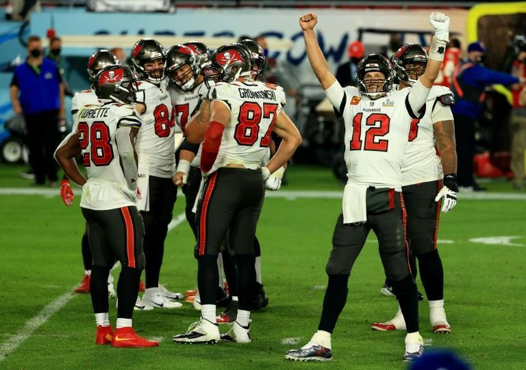 Tom Brady celebrates as the Tampa Bay Buccaneers storm to an emphatic Super Bowl upset over the Kansas City Chiefs