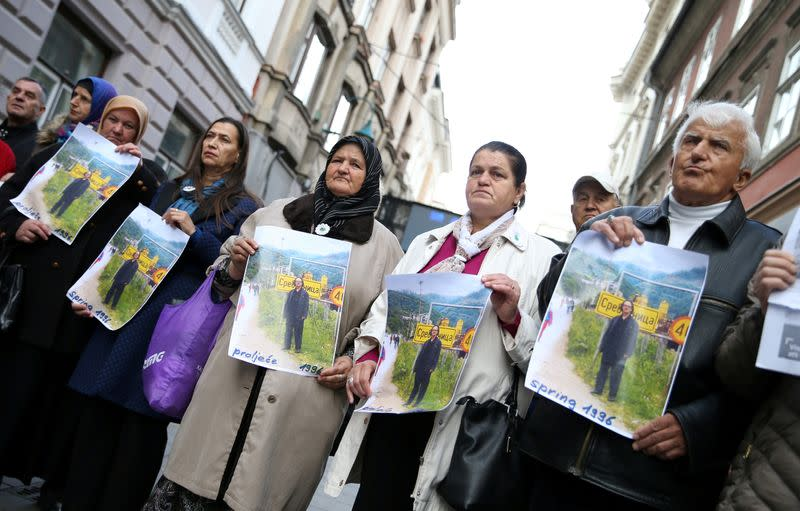 FILE PHOTO: Protesters from the Association of Victims and Witnesses of Genocide hold a picture of the winner of the 2019 Nobel Prize for Literature Peter Handke in Srebrenica, during a protest in front of Sweden embassy in Sarajevo, Bosnia
