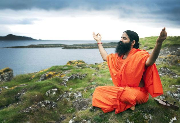 <p>Ram Kisan Yadav, better known as Ramdev, rose to fame teaching yoga and now heads an alternative medicine empire</p> (Getty Images)