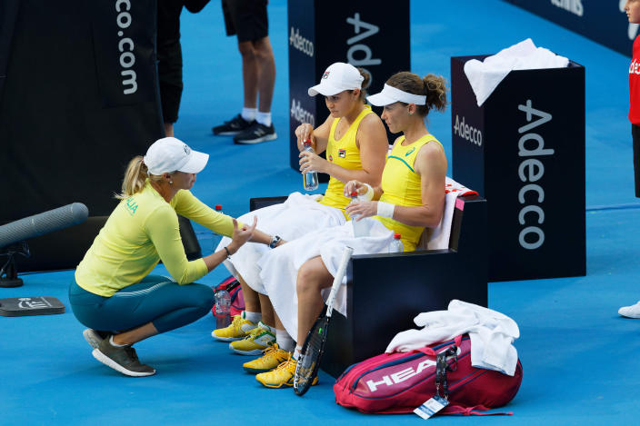 Australian captain Alicia Molik urges her players Ash Barty and Sam Stosur during a points break during their Fed Cup tennis final in Perth, Australia, Sunday, Nov. 10, 2019. (AP Photo/Trevor Collens)