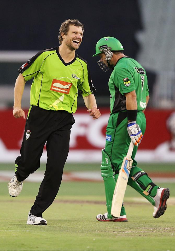 MELBOURNE, AUSTRALIA - JANUARY 08:  Dirk Nannes (L) of The Sydney Thunder celebrates his dismissal of Brad Hodge during the Big Bash League match between the Melbourne Stars and the Sydney Thunder at Melbourne Cricket Ground on January 8, 2013 in Melbourne, Australia.  (Photo by Michael Dodge/Getty Images)