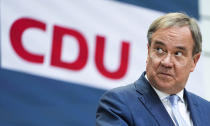 FILE - In this Monday, Sept. 27, 2021 file photo, candidate for chancellor of the Christian Union parties Armin Laschet brief the media after a leaders meeting of his Christian Democratic Union party CDU at the headquarters in Berlin. As Europe's economic powerhouse Germany embarks on the task of piecing together a new ruling coalition after the knife-edge election on Sunday Sept. 26, 2021, the country need only look to its neighbors, Belgium and the Netherlands, to see how tricky the process can be. (AP Photo/Martin Meissner, file)