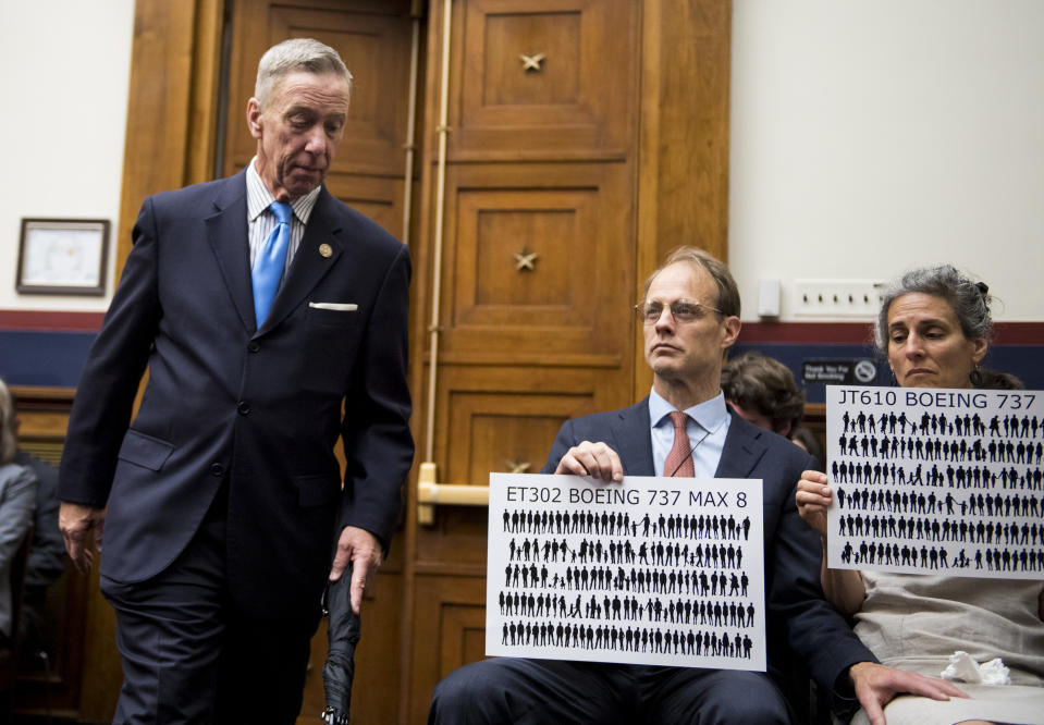 """UNITED STATES - JUNE 19: Rep. Stephen Lynch, D-Mass., arrives as Michael Stumo and his wife Nadia Milleron, the parents of Samya Rose Stumo, hold up signs depicting those lost in Ethiopian Airlines Flight 302 and Lion Air Flight 610 during the House Transportation and Infrastructure Subcommittee on Aviation hearing on """"Status of the Boeing 737 MAX: Stakeholder Perspectives"""" on Wednesday, June 19, 2019. (Photo By Bill Clark/CQ Roll Call)"""