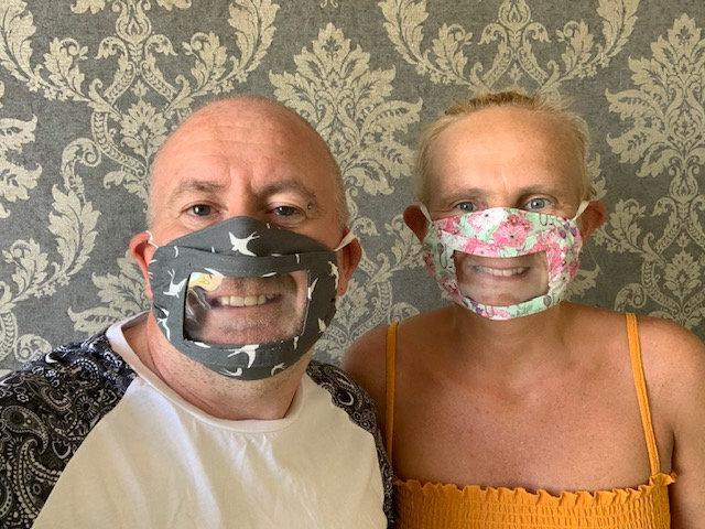 Justine Bate and her husband Carl modelling the masks, which enable deaf people to lip read. (SWNS)