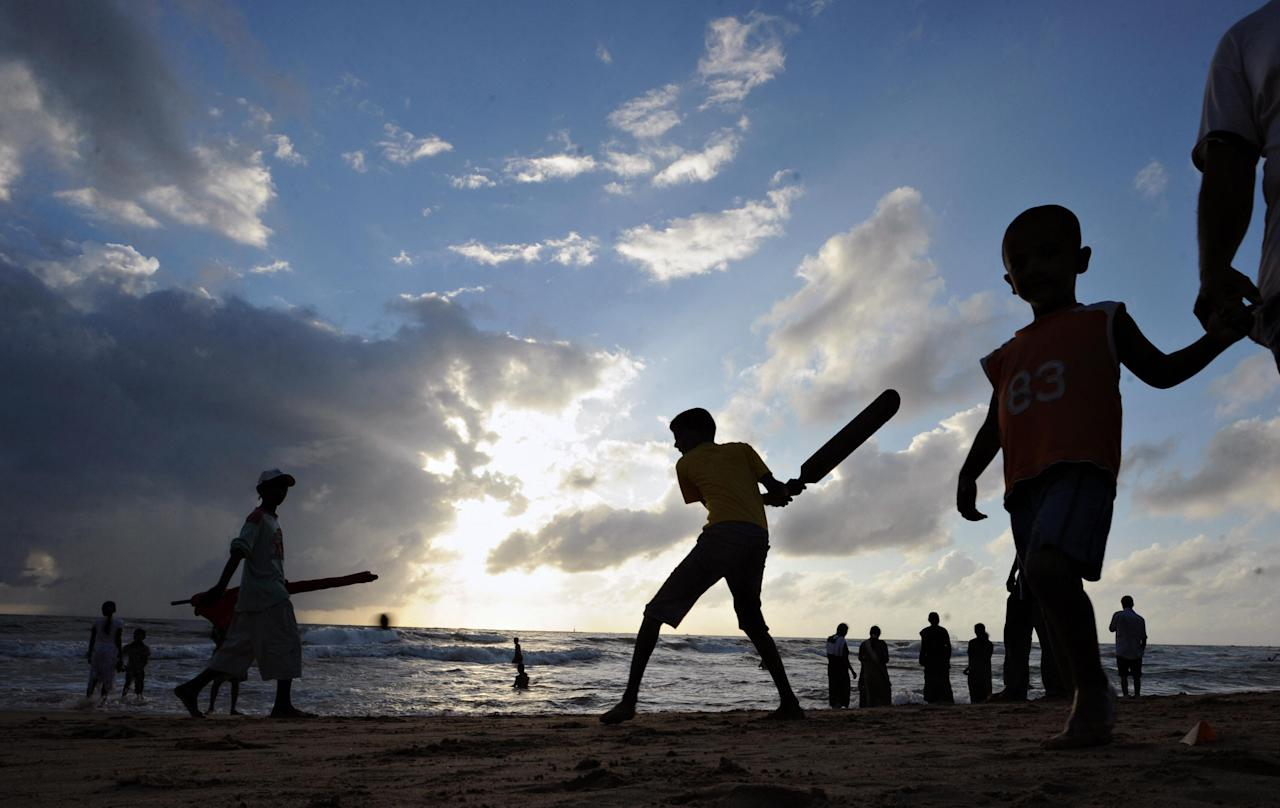 Sri Lankan children play cricket on a beach in Colombo on June 21, 2009. The ICC Twenty20 cricket World Cup finals match between Sri Lanka and Pakistan is currently ongoing at Lord's in London. AFP PHOTO/Lakruwan WANNIARACHCHI. (Photo credit should read LAKRUWAN WANNIARACHCHI/AFP/Getty Images)