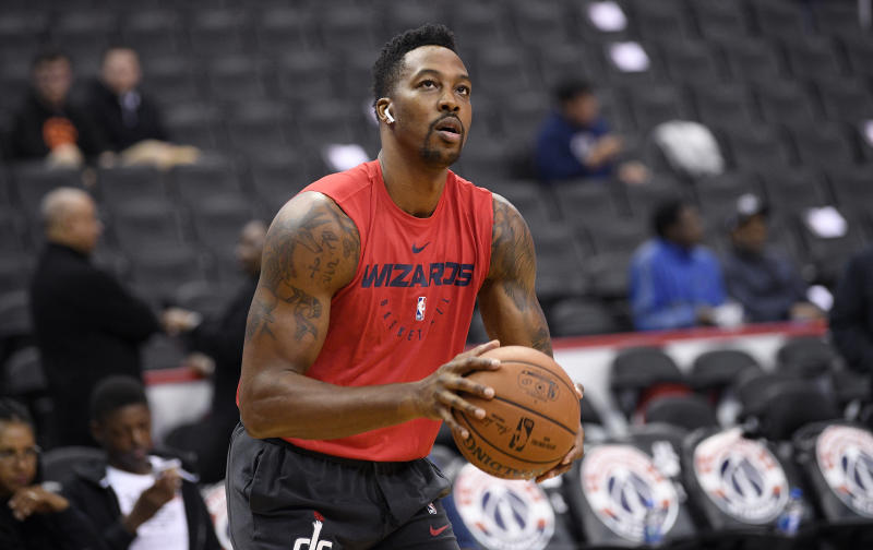 Washington Wizards center Dwight Howard (21) shoots around before an NBA basketball game against the Toronto Raptors, Saturday, Oct. 20, 2018, in Washington. (AP Photo/Nick Wass)
