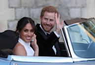 <p>Markle showed off her aquamarine ring gifted from Prince Harry on their wedding day on 19 May 2018 as they sped off in a converted Jaguar to their wedding reception festivities. They couldn't look happier. </p>