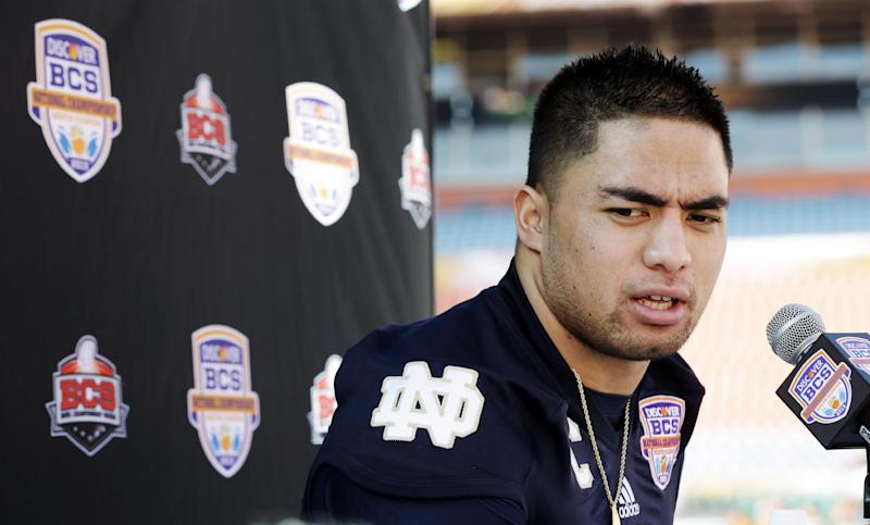 FILE - In this Jan. 5, 2013, file photo, Notre Dame linebacker Manti Te'o answers a question during media day for the BCS national championship NCAA college football game in Miami. The wrenching story of Te'o's girlfriend dying of leukemia _ a loss he said inspired him to play his best all the way to the BCS championship _ was dismissed by the school Wednesday, Jan. 16, as a hoax perpetrated against the linebacker. (AP Photo/David J. Phillip, File)