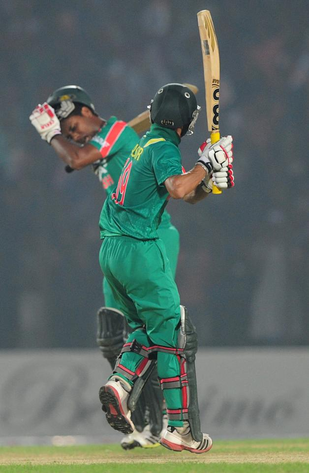 Bangladesh batsmen Sohag Gazi (L) and Nasir Hossain (R) react after winning the third One-Day International (ODI) cricket match between Bangladesh and New Zealand at Khan Jahan Ali Stadium in Fatullah on the outskirts of Dhaka on November 3, 2013 . Bangladesh win the series against New Zealand by 3-0. AFP PHOTO/ Munir uz ZAMAN        (Photo credit should read MUNIR UZ ZAMAN/AFP/Getty Images)