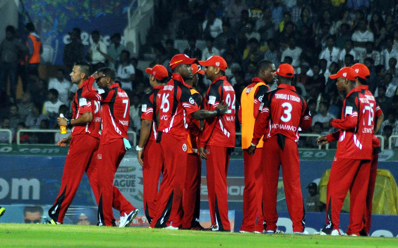 Trinidad & Tobago players celebrate after taking a wicket during the Champions League T20, 2nd match, Group B between Brisbane Heat and Trinidad & Tobago at JSCA International Cricket Stadium, Ranchi on Sept. 22, 2013. (Photo: IANS)