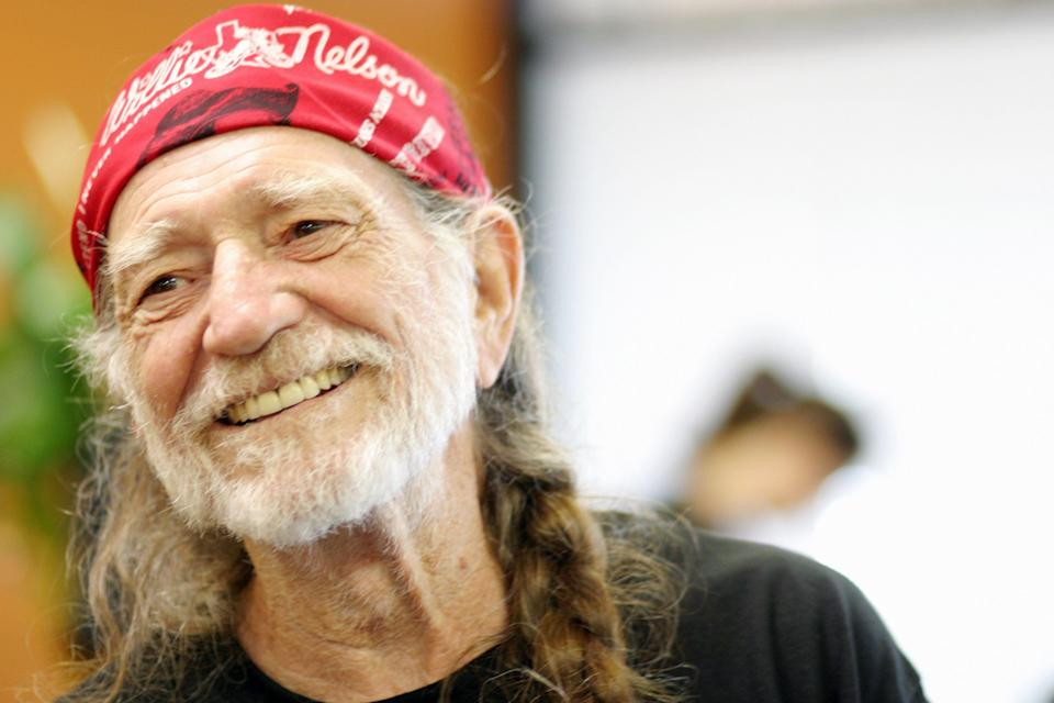 """03/14/05. Willie Nelson at Master Teacher Sam Um's Gym Kick & Box in Austin. Nelson, who earned his black belt in Tai Kwon Do at the age of 70, is preparing for fight scenes in Newline Cinema's western """"Life Is A Hoss"""" which have been choreographed by Um for the movie. Um has been Nelson's instructor for about 10 years."""