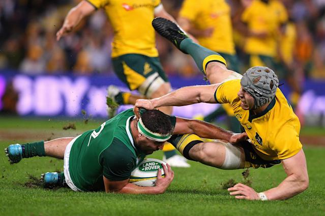 Rugby Union - June Internationals - Australia vs Ireland - Lang Park, Brisbane, Australia - June 9, 2018 - David Pocock of Australia tackles Rob Herring of Ireland. AAP/Dave Hunt/via REUTERS ATTENTION EDITORS - THIS IMAGE WAS PROVIDED BY A THIRD PARTY. NO RESALES. NO ARCHIVE. AUSTRALIA OUT. NEW ZEALAND OUT.