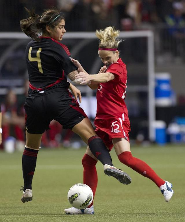 VANCOUVER, CANADA - JANUARY 27: Kelly Parker #15 of Canada and Alina Garciamendez #4 of Mexico battle for the loose ball during the first half of semifinals action of the 2012 CONCACAF Women's Olympic Qualifying Tournament at BC Place on January 27, 2012 in Vancouver, British Columbia, Canada. (Photo by Rich Lam/Getty Images)