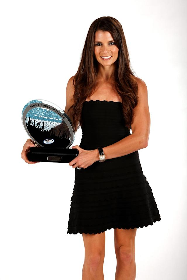 MIAMI BEACH, FL - NOVEMBER 19: Nationwide driver Danica Patrick poses with the Most Popular Driver Award during the NASCAR Nationwide Series And Camping World Truck Awards Banquet at Loews Miami Beach on November 19, 2012 in Miami Beach, Florida. (Photo by Chris Trotman/Getty Images for NASCAR)
