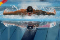 Caeleb Dressel, of the United States, swims in the men's 100-meter butterfly final at the 2020 Summer Olympics, Saturday, July 31, 2021, in Tokyo, Japan. (AP Photo/Gregory Bull)