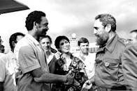 <p>U.S. Presidential candidate Jesse Jackson, left, and Cuban President Fidel Castro shake hands as they say goodbye in Havana, Cuba, June 27, 1984. At center is Juanita Vera, Castro's personal interpreter. Jackson will return to Havana after his trip to Nicaragua to pick up the released American prisoners to take with him to Washington, D.C. Jackson and Castro met over two days seeking solutions to better U.S.-Cuba relations. (AP Photo/Scott Applewhite) </p>