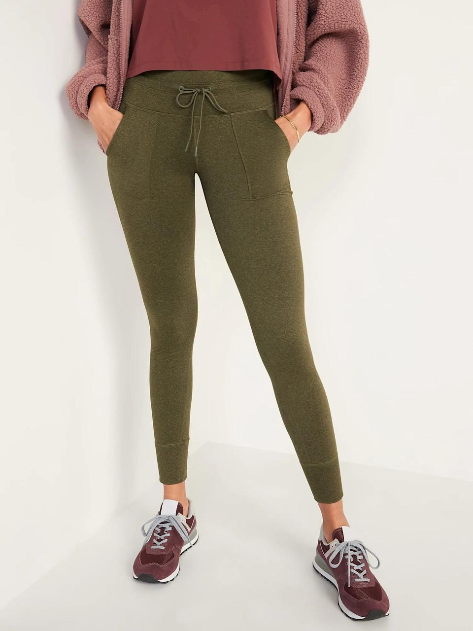 <p>Choosing a hybrid like the <span>Old Navy High-Waisted CozeCore Jogger Leggings</span> ($40) mean you get soft pants that are fitted but not too tight. Several shades reminded us of fall but the bark brown and this moss green are especially nice.</p>