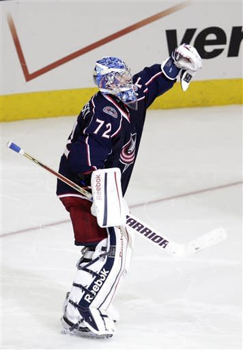 Columbus Blue Jackets' Sergei Bobrovsky, of Russia, celebrates his win against the Phoenix Coyotes after a shootout in an NHL hockey game on Saturday, March 16, 2013, in Columbus, Ohio. The Blue Jackets defeated the Coyotes 1-0. (AP Photo/Jay LaPrete)