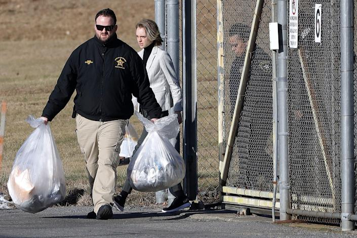 Michelle Carter, center, leaves the Bristol County jail, Thursday, Jan. 23, 2020, in Dartmouth, Mass., after serving most of a 15-month manslaughter sentence for urging her suicidal boyfriend to kill himself in 2014. The 23-year-old, released three months early for good behavior, will serve five years of probation.