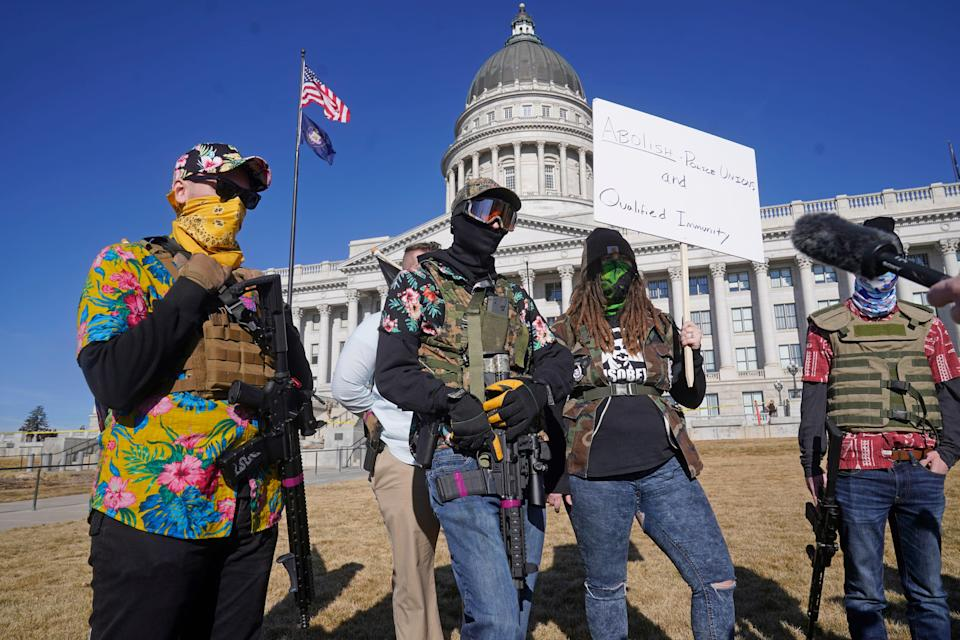 Armed protesters gather at the Utah State Capitol Sunday, Jan. 17, 2021, in Salt Lake City.