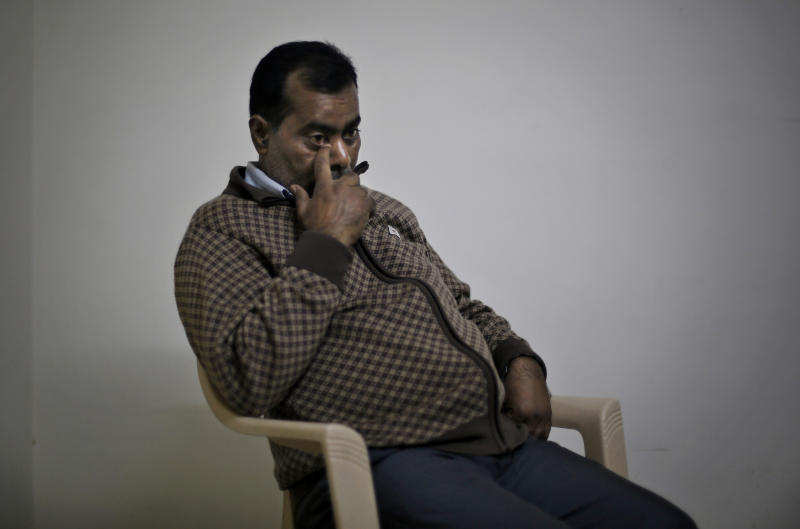 """In this Nov. 29, 2013 photo, Badri Singh, father of the Delhi gang-rape victim, wipes a tear while speaking during an interview at the family's three-room apartment in the outer suburbs of New Delhi, India. The victim, a 23-year-old physiotherapy student, was heading home with a male friend after an evening showing of the movie """"Life of Pi"""" when six men lured them onto a private bus. With no one else in sight, they beat the man with a metal bar, raped the woman and used the bar to inflict massive internal injuries. The pair were dumped naked on the roadside, and the woman died two weeks later. (AP Photo/Altaf Qadri)"""