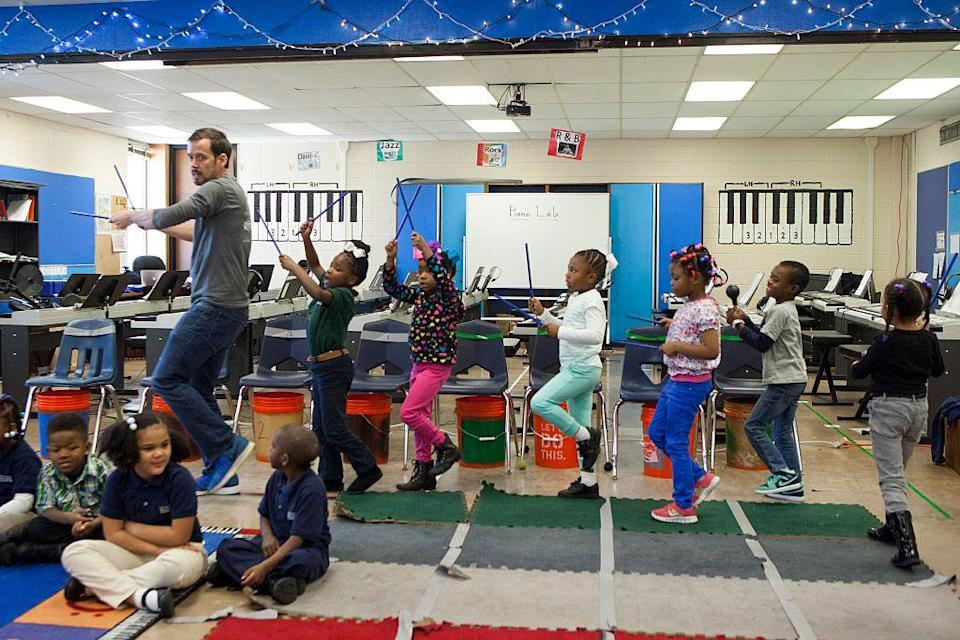 <p>Music teacher Thomas Murley leads a class at the Sylvanie Williams College Prep in New Orleans, Louisiana. </p>