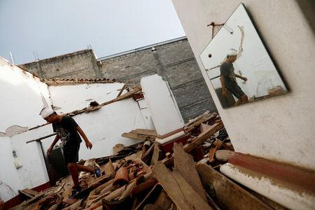Death toll from southern Mexico's big quake rises to 96