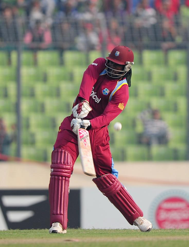 West Indies cricketer Chris Gayle plays a shot during the fourth one day international cricket match between Bangladesh and the West Indies  at the Sher-e-Bangla National Cricket Stadium in Dhaka on December 7, 2012. AFP PHOTO/ Munir uz ZAMAN