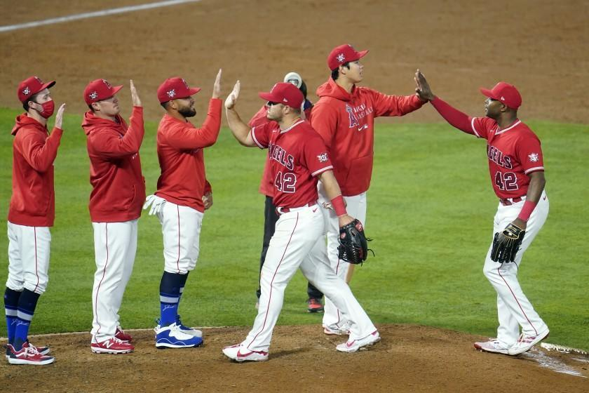 The Angels celebrate after a win over the Minnesota Twins on April 16, 2021, in Anaheim, Calif.