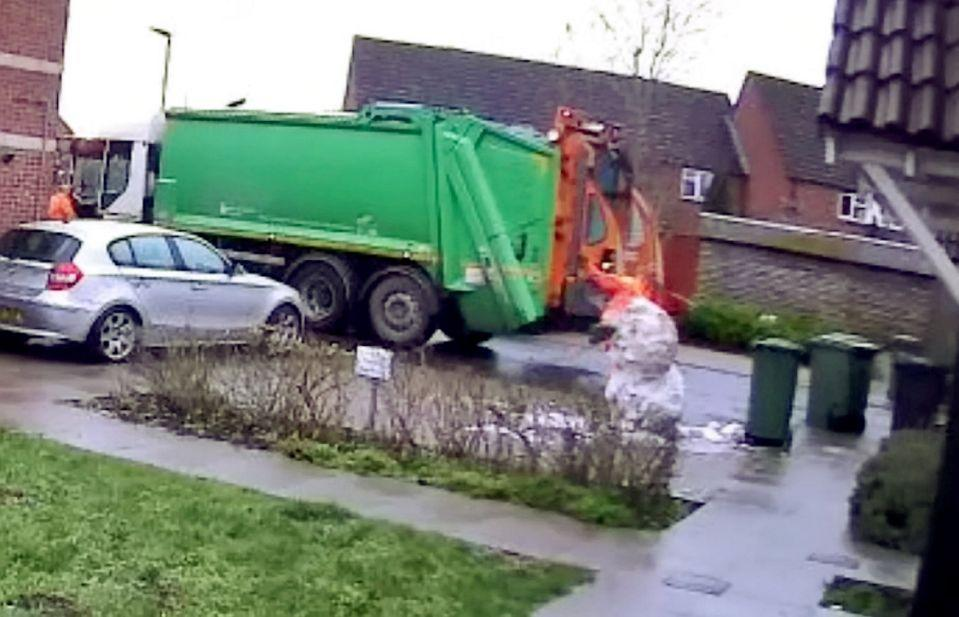 The binman jumped and kicked the snowman as he was passing on his rounds (SWNS)